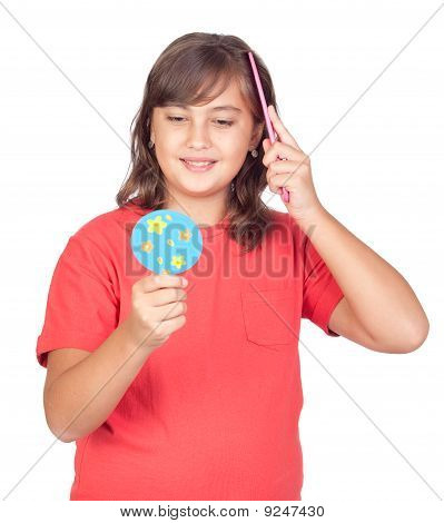 Preteen Girl Combing With A Comb In Front Of A Mirror