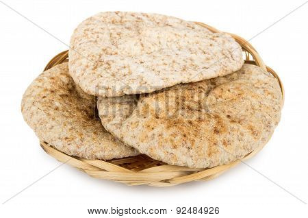 Three Small Pitas In Wicker Basket