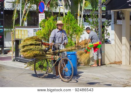 Thais Selling Brooms On The Streets