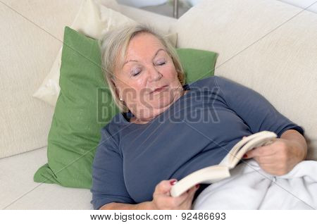 Close Up Middle Aged Blond Woman Resting On Couch