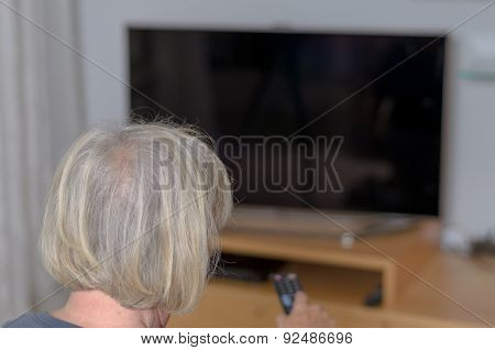 White Haired Adult Woman Holding Tv Remote Control