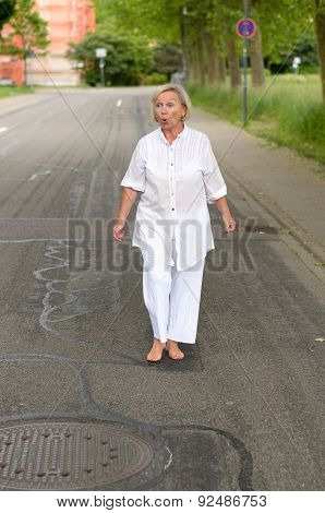 Shocked Senior Woman Walking At The Street Alone