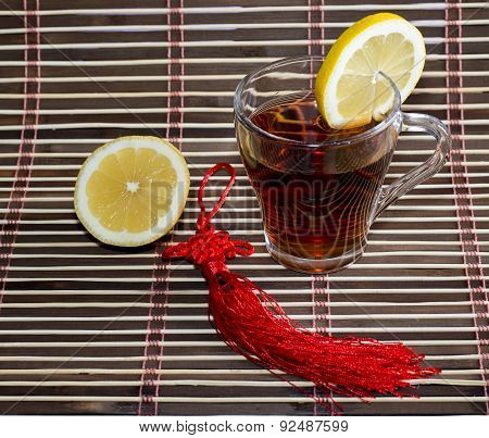 Glass Of Tea On A Rug With A Lemon
