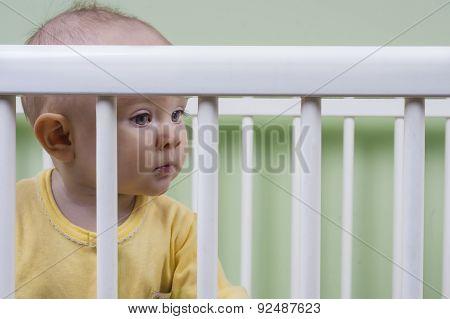 Baby Sitting In Her Crib