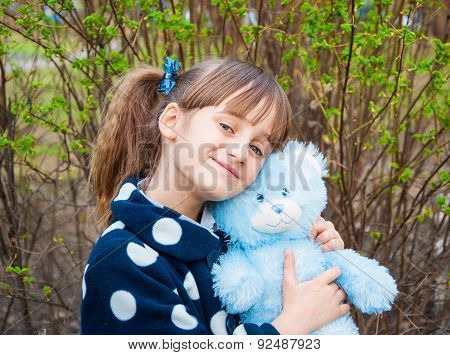 Portrait of a little girl with a teddy bear