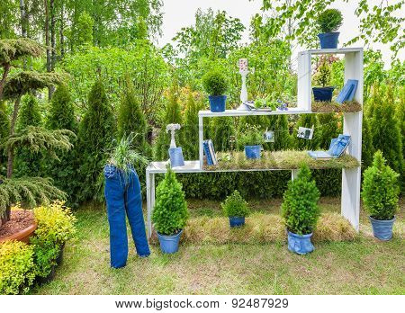 Minsk, Belarus, 23-may-2015: Garden Composition -  Bookshelf With Books And Potted Plants, Figure Fr