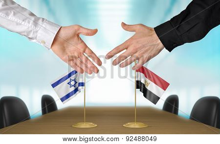 Israel and Egypt diplomats agreeing on a deal