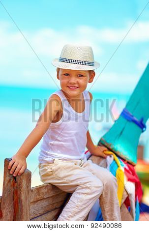 Cute Smiling Boy, Kid Sitting In Long Tail Boat On Tropical Beach