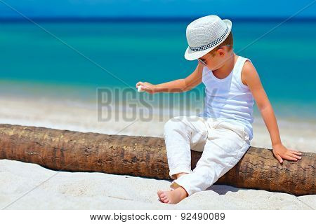 Cute Fashionable Kid, Boy Playing With Shell On Tropical Beach