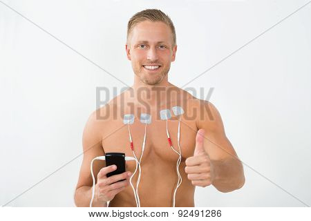 Man With Electrodes Showing Thumbs Up