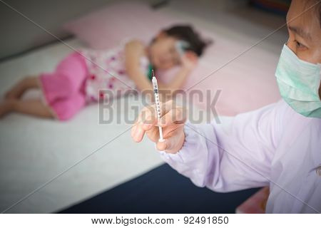 Lady Doctor Preparing An Injection For A Little Asian Girl