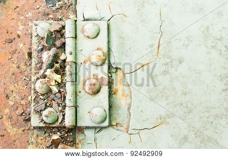 Hinge And Rust And Rivet On Old Light Green Metal Sheet Of Car Part