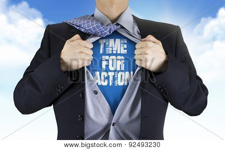 Businessman Showing Time For Action Words Underneath His Shirt