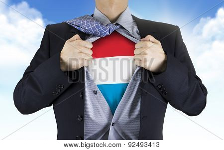 Businessman Showing Luxembourg Flag Underneath His Shirt