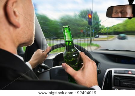 Businessman Drinking Beer While Driving Car