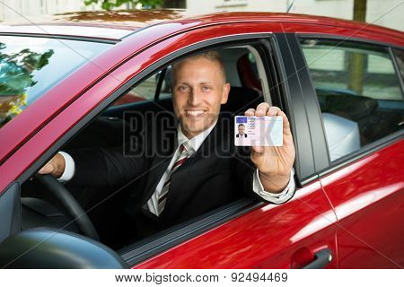 Businessman Showing His Driving License