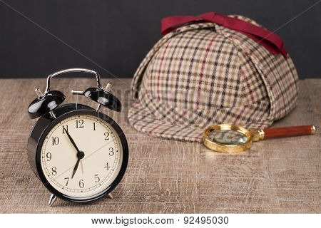 Hat And Magnifying Glass