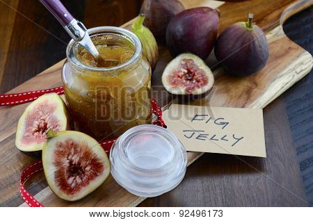 Fresh Figs And Preserve On Wood Table