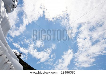 white Buddha on sky background