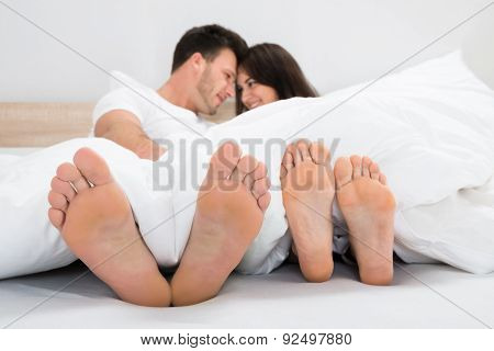 Romantic Couple On Bed