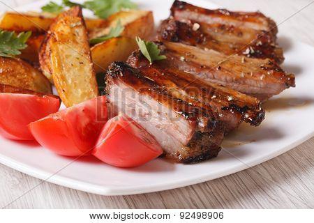 Roasted Spareribs, Potatoes And Tomatoes Closeup. Horizontal