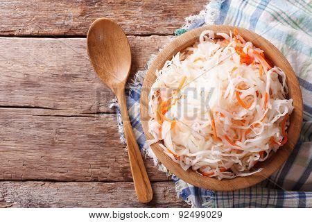 Sauerkraut In A Wooden Plate Horizontal Top View, Rustic