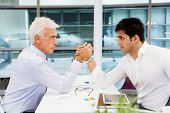 image of wrestling  - Two businessmen competeting arm wrestling in office - JPG