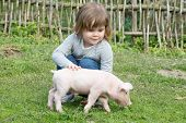 stock photo of piglet  - White piglet in girls hands smiling - JPG