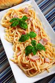 picture of carbonara  - Spaghetti carbonara decorated with fresh basil leaves - JPG