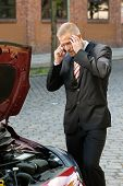 picture of breakdown  - Stressed Young Man Calling On Cellphone For Service With His Breakdown Car - JPG