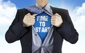 foto of start over  - businessman showing Time to start words underneath his shirt over blue sky - JPG