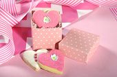 stock photo of bridal shower  - Valentine or Wedding heart shape pink and white cookies in polka dot wedding or bridal shower gift favor box - JPG