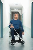 stock photo of crutch  - Portrait Of Mid - JPG