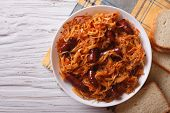 picture of stew  - stewed cabbage with sausages in white plate - JPG