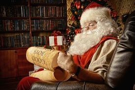 picture of boys night out  - Santa Claus dressed in his home clothes sitting in the room by the fireplace and Christmas tree - JPG