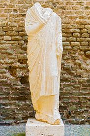 stock photo of toga  - Mausoleum of Caecilia Metella Via Appia. Statue of the men was placed outside the tomb to identify the dead whose sculpted portrait was added to the body. Men wore the distinctive Roman toga. ** Note: Soft Focus at 100%, best at smaller sizes - JPG