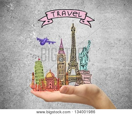 Travel concept with male hand holding abstract sights sketch on concrete background