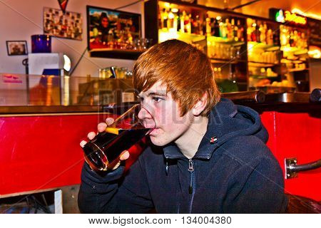 Young Boy Is Drinking