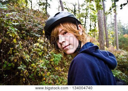 Young Boy On Tour With The Bike, Beeing Happy And Self Confident
