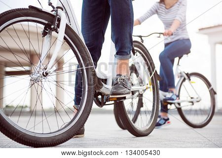 Are you ready for riding. Legs of a man and a woman standing with bicycles ready to start riding