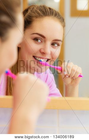 Woman Brushing Cleaning Teeth In Bathroom