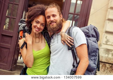 Beautiful couple of tourists in love enjoy their journey