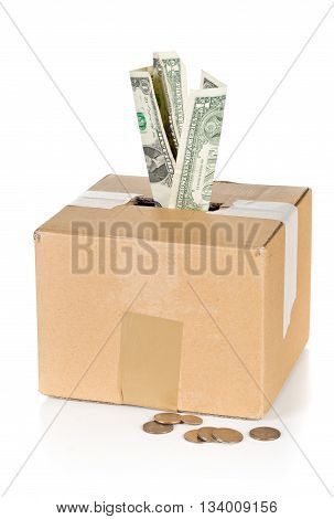 Donation carton box with dollar bills and coins over white background