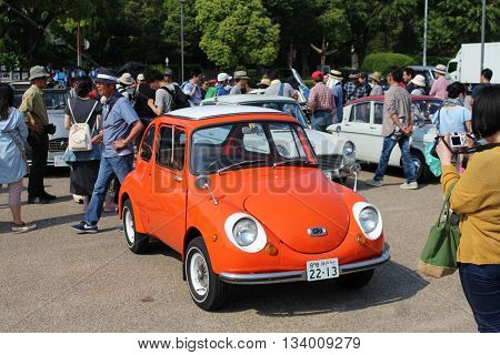 HIMEJI, JAPAN - MAY 20, 2016: An orange Subaru 360 is spotted at the Himeji Castle Festival