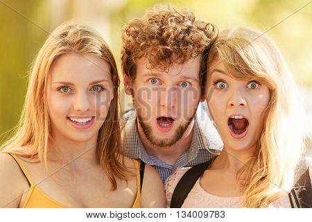 Three Surprised Young People Friends Outdoor.