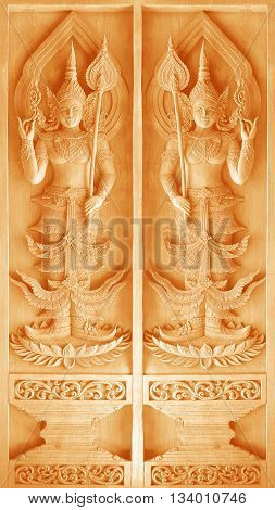 Traditional Thai style wood carving on the wall of Temple in Thailand