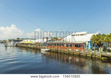NAPLES, USA - AUG 3, 2013: old city dock in tropical Naples Florida