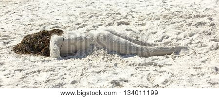 Woman Lying At The Beach Formed With Sand