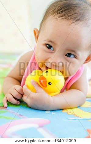 Cute Baby Girl Playing With Robber Duck Toy