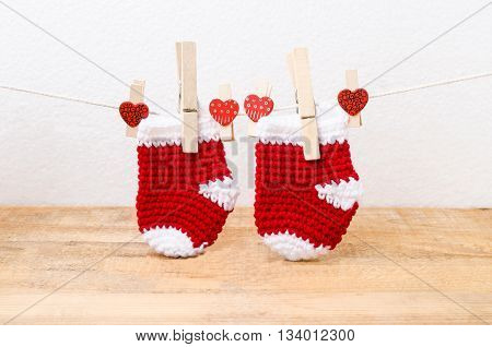 Knitted Baby Socks Hanging On The Clothesline
